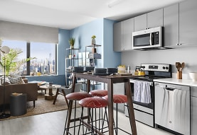kitchen with natural light, electric range oven, stainless steel appliances, white cabinetry, and light hardwood flooring, Journal Squared