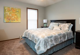 carpeted bedroom featuring natural light, Creekstone Falls