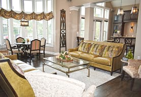 hardwood floored living room featuring a healthy amount of sunlight, The Ravines at Westar