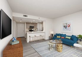 living room featuring a breakfast bar, microwave, TV, and range oven, AVA Ballston Square