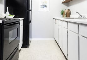 kitchen featuring range oven, light tile flooring, white cabinets, and light countertops, City Side