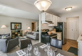 hardwood floored dining area with refrigerator, electric range oven, and exhaust hood, Bloomfield Square Apartments