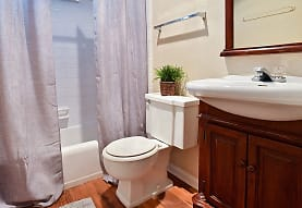full bathroom with hardwood floors, oversized vanity, mirror, toilet, washtub / shower combination, and shower curtain, Acadian and South College Gardens