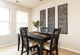 dining area featuring carpet and a wealth of natural light, City Side