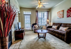 carpeted living room featuring a ceiling fan, a healthy amount of sunlight, and TV, Audubon Lake Apartment Homes