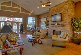 living room with hardwood flooring, a fireplace, lofted ceiling, natural light, a ceiling fan, and TV, Haven at Knob Creek