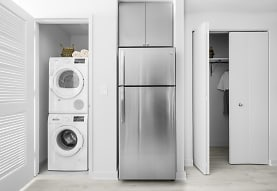 washroom featuring parquet floors, refrigerator, and independent washer and dryer, Journal Squared