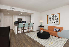 living room with a kitchen bar, hardwood floors, microwave, TV, and range oven, AVA Ballston Square