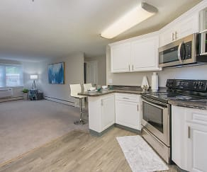 Updated kitchens with black fusion counter tops, wood-style flooring, and stainless steel appliances., The Willows