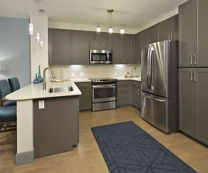 Stainless steel appliances and contemporary pendant and track lighting, District at Biltmore