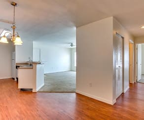 Large living area with modern light fixtures and hardwood floors, Spinnaker Reach