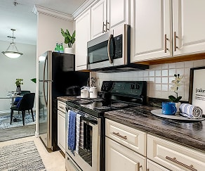 Newly renovated kitchens featuring black-fusion counter tops, white cabinetry, and wood-style flooring., ELEVATE 155