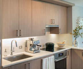 Modern kitchens featuring Bosch(tm) and Thermador(tm) appliances, including paneled refrigerators and dishwashers, Element 28