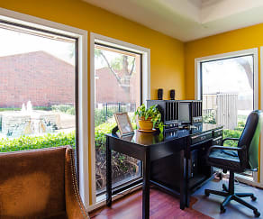 A desk and chairs in the leasing office overlooking the property, Wildflower Apartment Homes