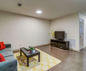 Living Room, University Center Apartments-Per Bed Leases