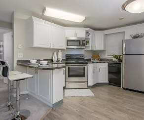 Updated kitchens with stainless steel appliances are available., The Willows