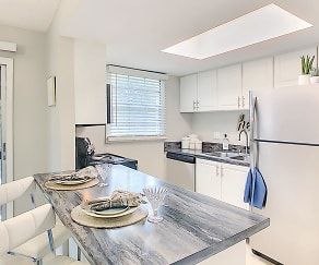 Newly renovated kitchens with updated white cabinetry and black fusion countertops., The Preserve at Spring Lake
