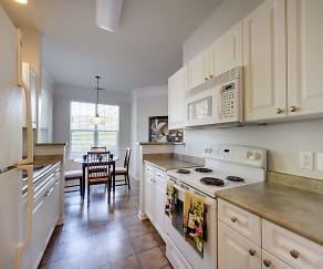 Kitchen with white appliance package and tile floors, Falls Pointe at the Park