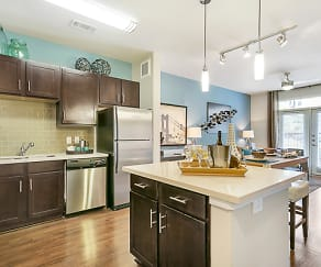 Luxurious kitchen, stainless steel appliances, stunning large islands and faux wood flooring., Trinity Urban Apartments - Bluff & District