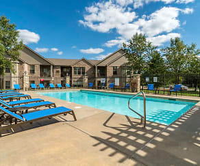 On a hot day, you'll love taking a dip in the pool and relaxing in the lounge chairs., Stone Creek Villas