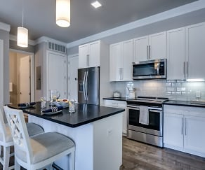 Luxurious kitchen with subway tiled backsplash and stainless steel appliances, The Monarch