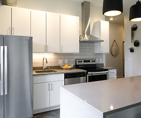 Beautifully appointed kitchen with quartz countertops and stainless steel appliances., Green on Fourth