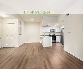 Premium finish living, dining, and kitchen area with hard surface plank flooring (in select homes), eaves Thousand Oaks