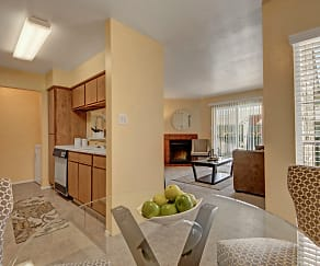 A dining room off the kitchen with a view into the living area, High Plains Apartments