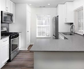 Newly renovated kitchen with quartz countertops and hard surface plank flooring (in select homes), Avalon at Bedford Center