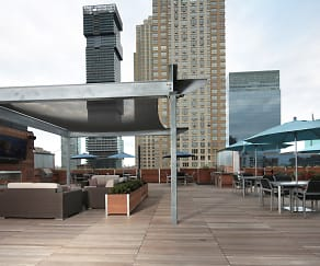 Rooftop deck features lounge area, fireplace and flatscreen TV, Modera Lofts