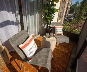 Enjoy the outdoors from your very own private patio located right outside the living room., Adele Place