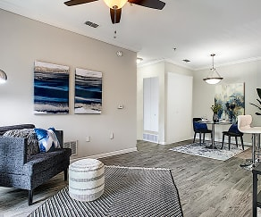 Updated living rooms with wood-style flooring., The Landings on East Hill