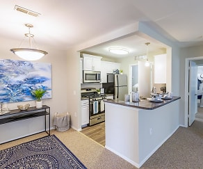 Spacious open floor plans featuring a breakfast bar and separate dining area., BLVD West