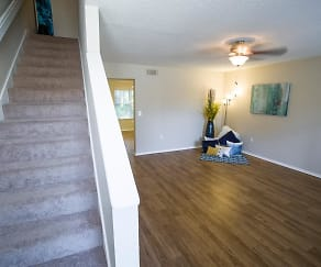 Fabulous, spacious living space to unwind at the end of your day featuring wood-style flooring and a ceiling fan., Lanier Landing