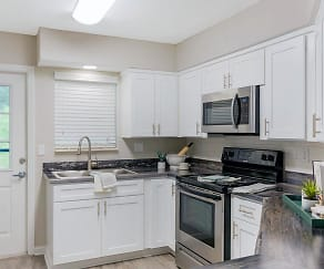 Open concept kitchens featuring wood-style flooring and breakfast bar., ONYX LUXURY APARTMENTS
