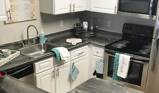 Updated kitchens with black fusion countertops, wood-style flooring, and stainless steel appliances., Welby Park Estates