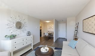 Spacious living room with luxe flooring at Equinox Apartments, Equinox Apartments