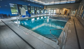 Pool with Garage doors that open up to patio on sunny days, U32 Apartments