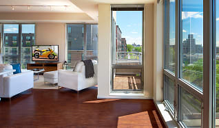 Floor-to-ceiling windows provide ample amounts of natural sunlight, Flux Apartments