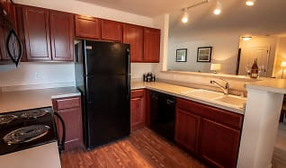 Classic kitchens featuring cherry cabinets and black appliances, Falcon Glen