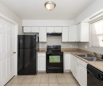 kitchen with refrigerator, electric range oven, dishwasher, fume extractor, light tile floors, dark granite-like countertops, and white cabinetry, Country Club Apartments