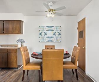 Spacious Dining Room with Hardwood Floors - Raindance Apartments, Raindance