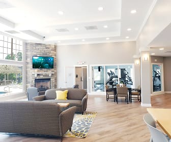living room featuring hardwood floors, a fireplace, and TV, Cobblestone Court