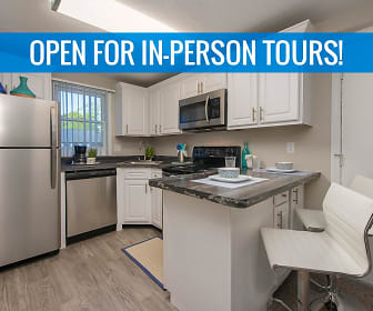 Newly renovated kitchens featuring black fusion counter tops, wood-style flooring, and stainless steel appliances. We are excited to offer in-person tours while following social distancing and we encourage all visitors to wear a face covering., Sugarloaf Estates