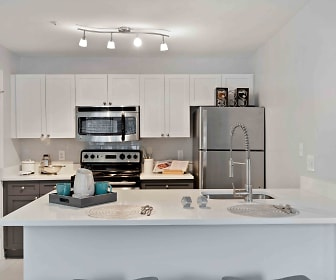 kitchen featuring stainless steel appliances, range oven, light flooring, white cabinets, and light countertops, Henley at Kingstowne