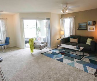 living room with a wealth of natural light, a ceiling fan, and carpet, TGM Bermuda Island