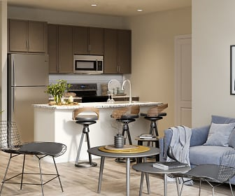 Gorgeous model home showcasing the sunlight shining through the large patio doors, the open kitchen with stainless steel appliances, granite countertops, and beautiful, vinyl wood plank flooring., Sapphire at Centerpointe