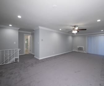 Gray Carpeted Living Room With Sliders To Terrace, Fairfield Courtyard At Bayport