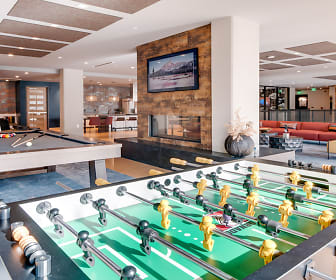 Enjoy a fun game of pool or foosball in our second floor clubroom, Modera Jack London Square