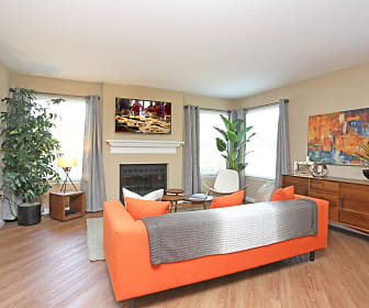 Spacious living room with wood-style plank flooring., Rosemeade Apartment Homes